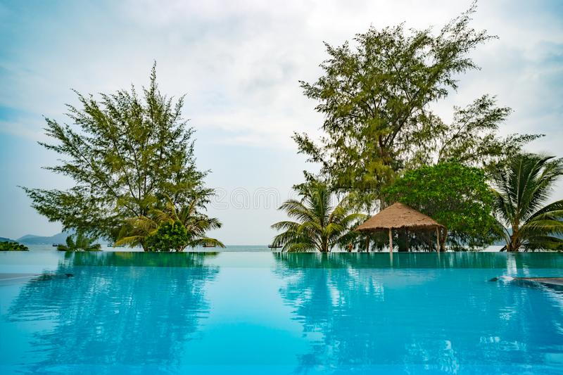 Outdoor swimming pool on an island in Cambodia. Seascape and swimming pool with open perspective, wonderful holiday stock photos