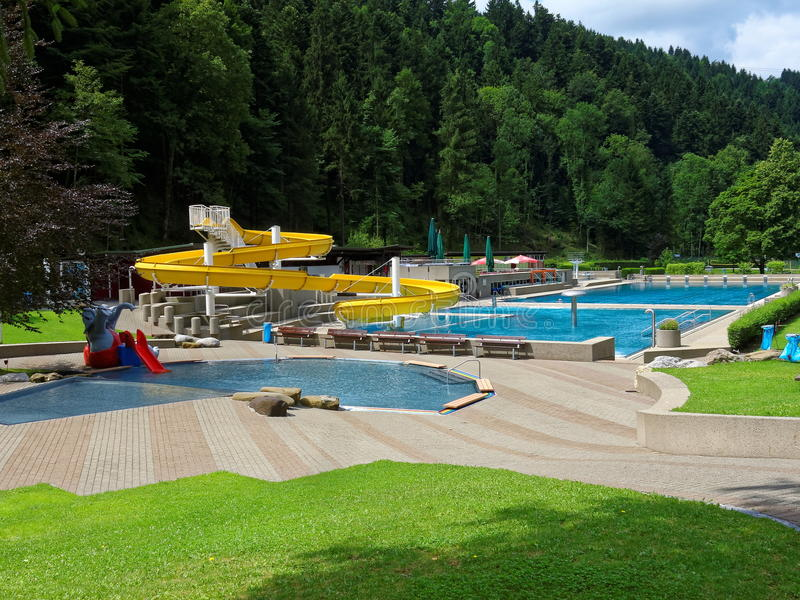 Outdoor pool with slide  Outdoor Swimming Pool Landscape With Slide Stock Image - Image of ...