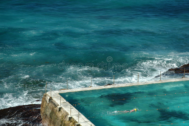 Outdoor swimming pool by sea stock photo