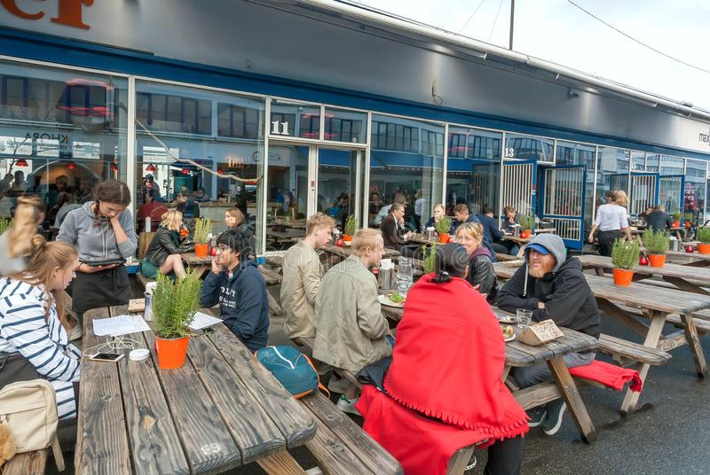 Outdoor tables of popular restaurant and hungry people waiting for food and drinks. COPENHAGEN, DENMARK - SEPT 7: Outdoor tables of popular restaurant and hungry royalty free stock image