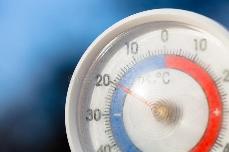 Outdoor thermometer with celsius scale showing severe freezing temperature stock photo