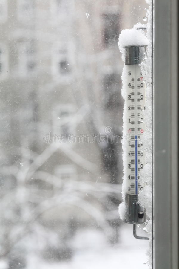 Outdoor thermometer in winter royalty free stock images