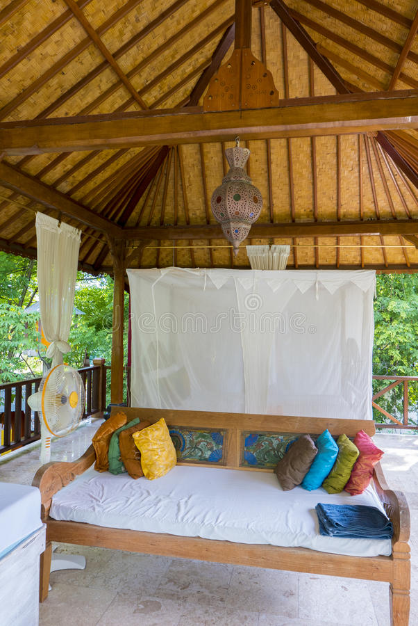Outdoor traditional bedroom on Gili Air tropical island. Indonesia stock photo