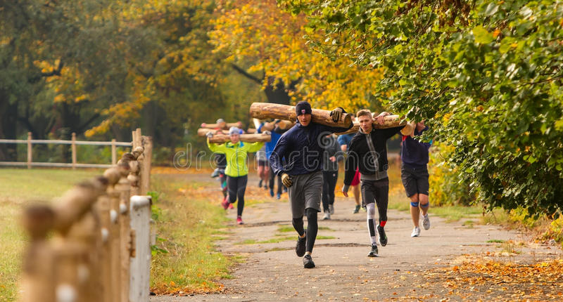Outdoor training CrossFit. Kyiv, Ukraine - October 08 2016. Outdoor CrossFit training, preparation for competition `Race Nation.` Autumn. Group of athletes stock images