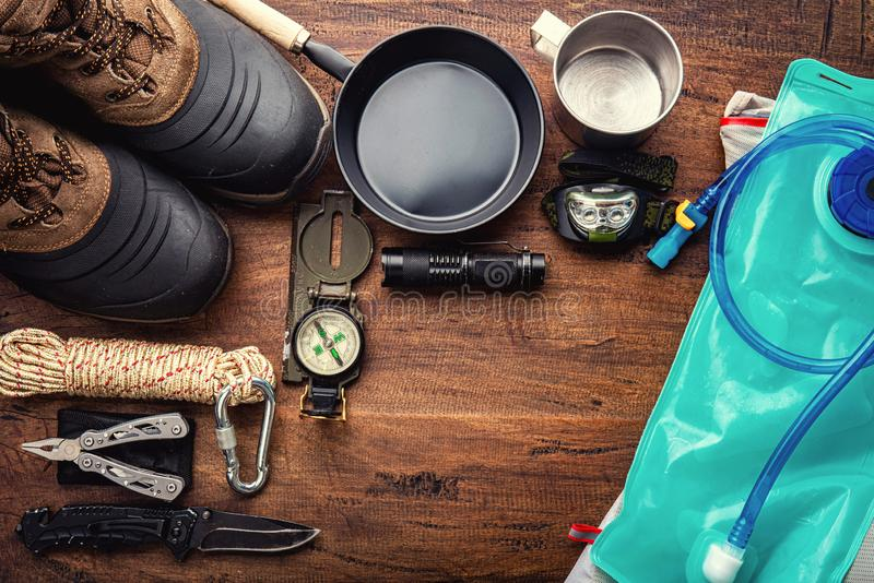 Outdoor travel equipment planning for a mountain trekking camping trip. On wooden background. Top view - vintage film grain filter effect styles stock photos