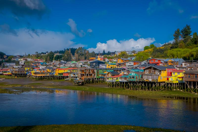 Outdoor view of colorful houses on stilts palafitos in the horizont located in Castro, Chiloe Island. In Chile stock photos