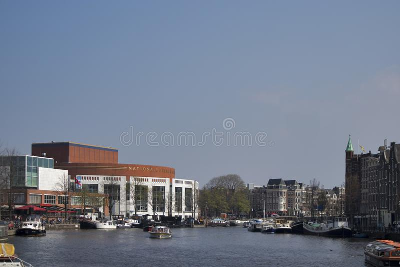 Outdoor view of Dutch National Opera Ballet. The Stopera is a building complex, housing both the city hall of Amsterdam and the Du stock photography
