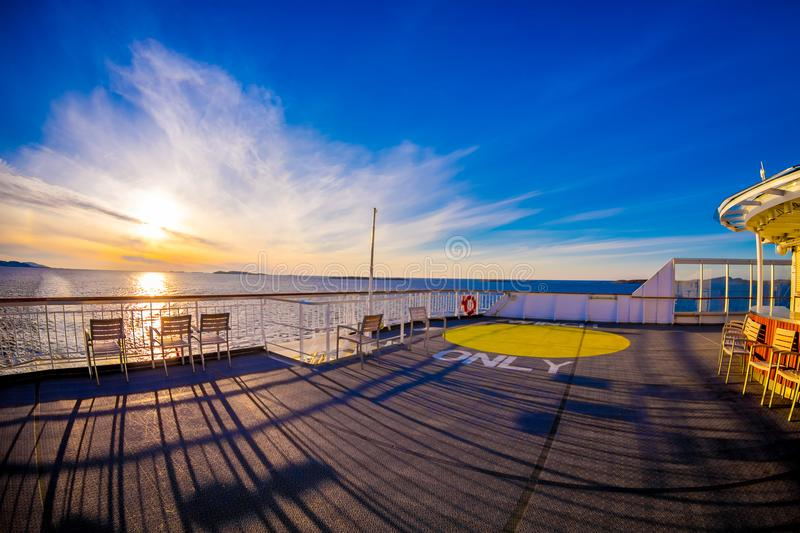 Outdoor view of empy area over the cruise ship in Hurtigruten area, from deck in a gorgeos blue sky and blue water. With sun shiny in Norway, fish eye effect royalty free stock photos