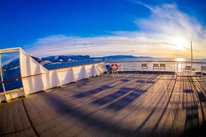 Outdoor view of empy area over the cruise ship in Hurtigruten area, from deck in a gorgeos blue sky and blue water. With sun shiny in Norway, fish eye effect royalty free stock photography