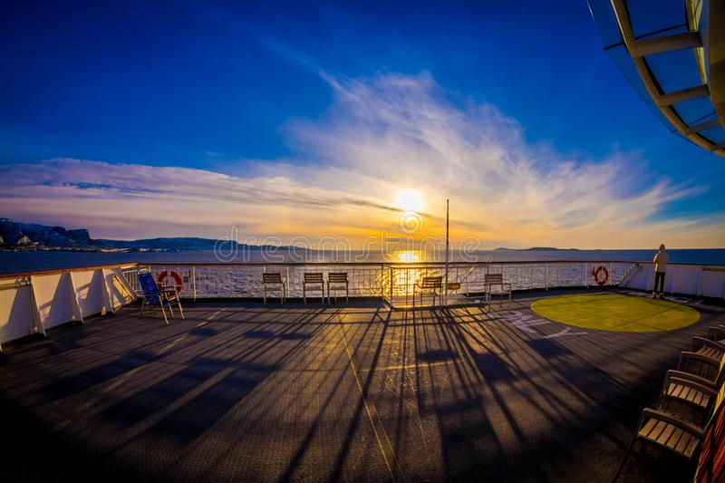 Outdoor view of empy area over the cruise ship in Hurtigruten area, from deck in a gorgeos blue sky and blue water. With sun shiny in Norway, fish eye effect stock image