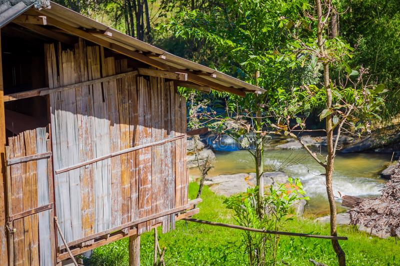 Outdoor view of a gorgeous house building with bamboo cane in tropical rainforest with a river behind in Chiang Mai. Province, Thailand stock photos