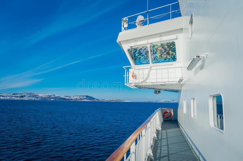 Outdoor view of Hurtigruten cruise trip, view from deck in a gorgeos blue sky and blue water. In Norway royalty free stock photos
