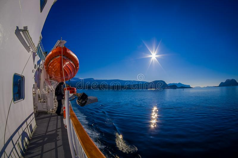 Outdoor view of Hurtigruten cruise, view from deck with a life boat in case an accident. In a gorgeous sunny day with blue sky, in Norway stock images