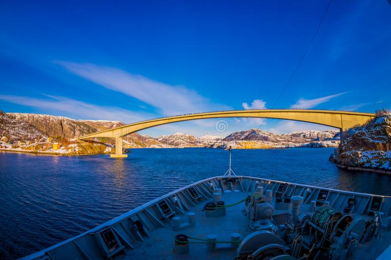 Outdoor view of hurtigruten Ship cruise, frontside with a huge bridge in front. Sailing in a blue sky in Norway stock images
