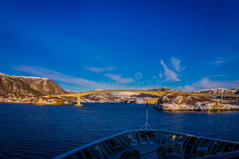 Outdoor view of hurtigruten Ship cruise, frontside with a huge bridge in front. Sailing in a blue sky in Norway royalty free stock photos