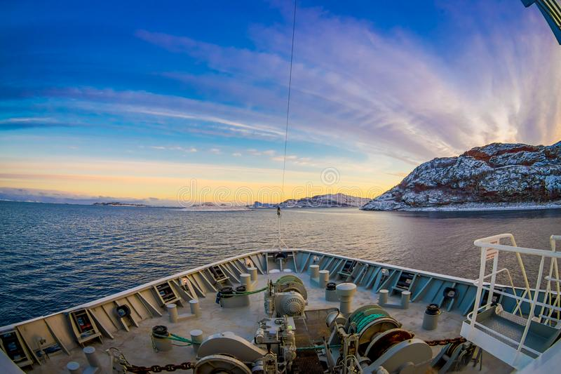 Outdoor view of hurtigruten Ship cruise, frontside. Sailing in a blue sky in Norway royalty free stock image