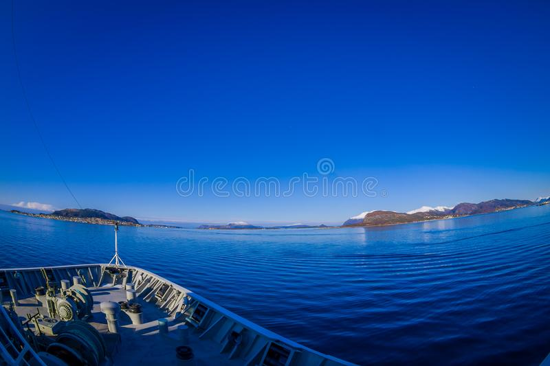 Outdoor view of hurtigruten Ship cruise, frontside. Sailing in a blue sky in Norway royalty free stock images
