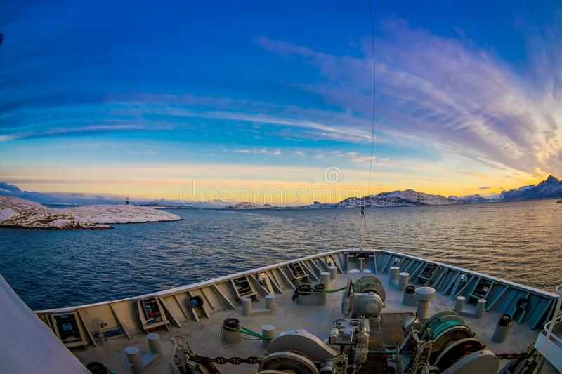 Outdoor view of hurtigruten Ship cruise, frontside. Sailing in a blue sky in a sunset in Norway stock photo