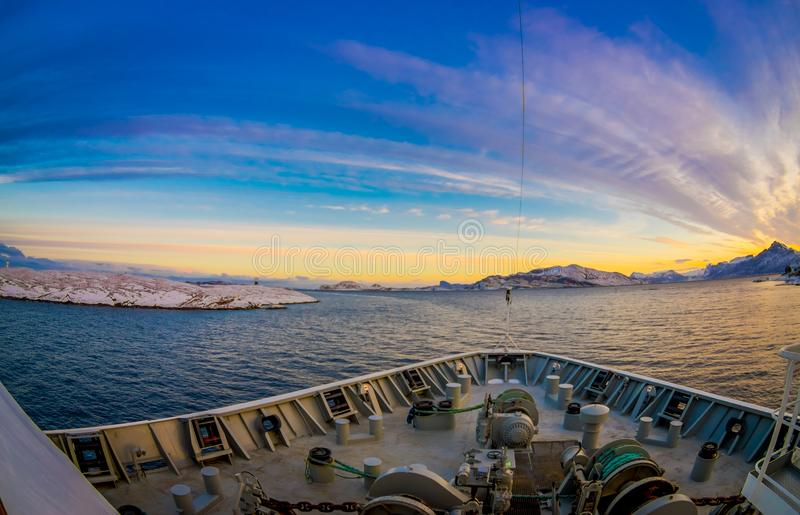 Outdoor view of hurtigruten Ship cruise, frontside. Sailing in a blue sky in a sunset in Norway royalty free stock photos