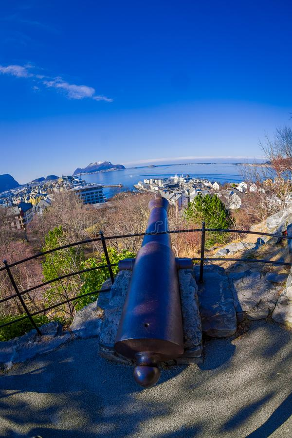 Outdoor view of metallic canon Aksla in Alesund, Norway. Fish eye effect royalty free stock images