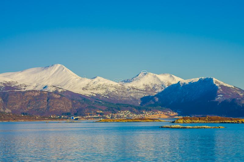 Outdoor view of mountain range in Norway. The beautiful mountain covered partial with snow in Hurtigruten region in. Norway royalty free stock image