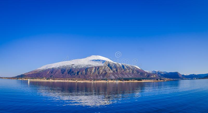 Outdoor view of mountain range in Norway. The beautiful mountain covered partial with snow in Hurtigruten region in. Norway stock photography