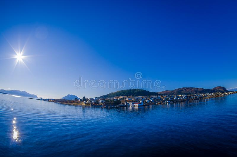 Outdoor view of mountain range in Norway. The beautiful mountain in Hurtigruten region with some buildings in the. Horizont in Norway royalty free stock images