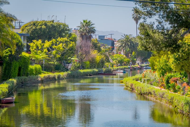 Outdoor view of unidentified people walking in the white bridge, and houses along a canal in Venice Beach, Los Angeles. California, USA royalty free stock images