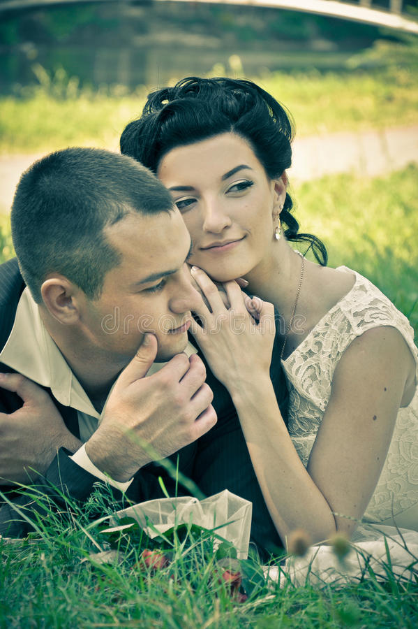 Outdoor vintage sensual portrait of pretty young couple in love royalty free stock images