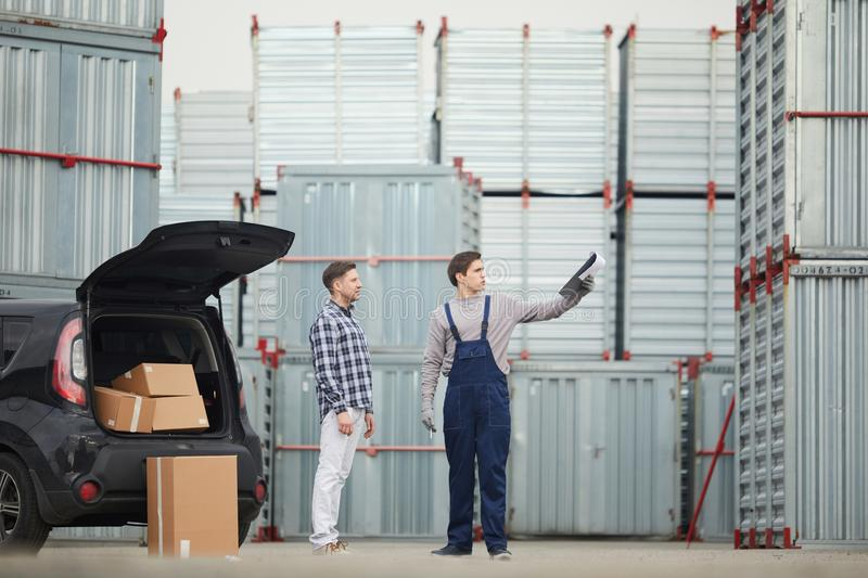 Outdoor warehouse manager explaining route to buyer stock photo
