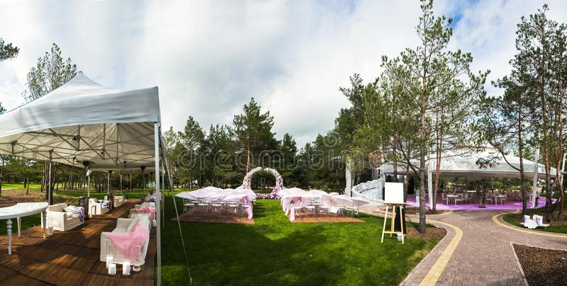 Outdoor wedding ceremony and banquet wedding tent stock photo