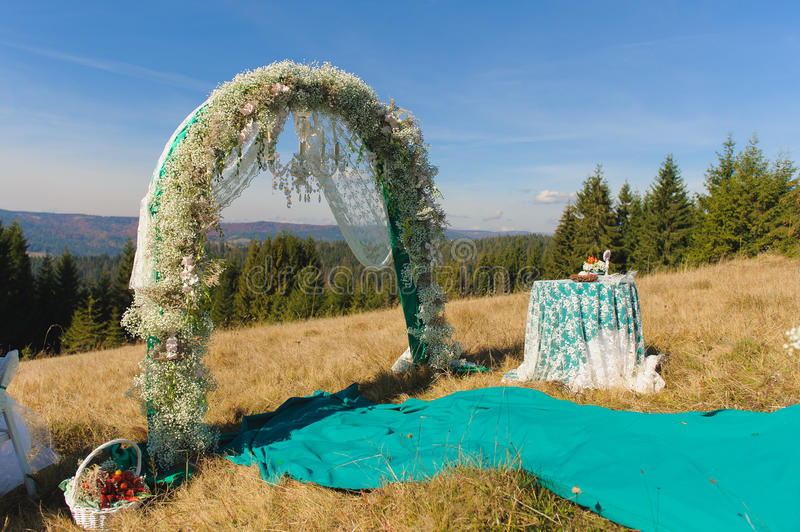 Outdoor wedding ceremony scene on a mountain slope royalty free stock images