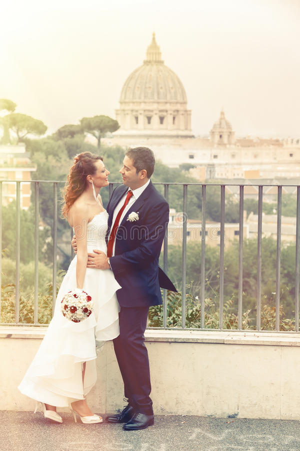 Outdoor wedding couple in town. Rome Italy. Vatican. Romance. royalty free stock photo