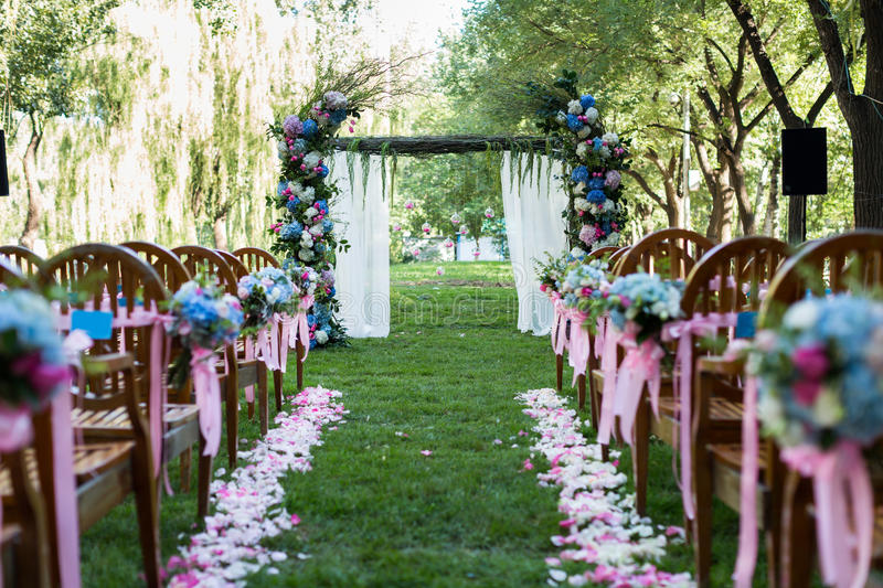 Outdoor wedding Scene. Chairs and flowers at an outdoor wedding stock photo