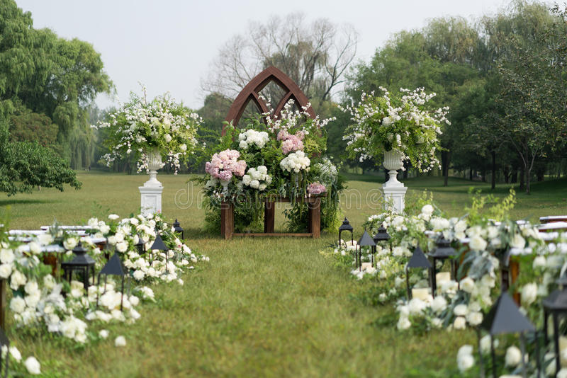 Outdoor wedding Scene. Chairs and flowers at an outdoor wedding stock photos