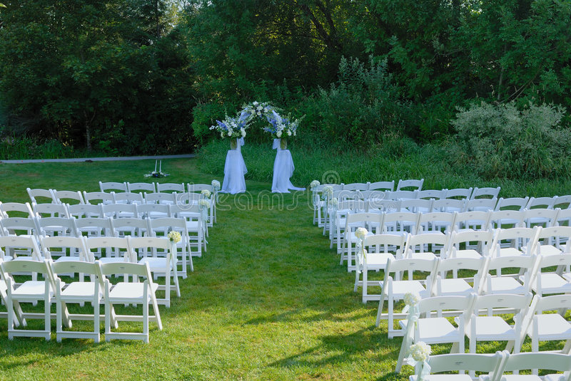 Outdoor Wedding Venue. Outdoor wedding reception venue set up with white chair stock photography