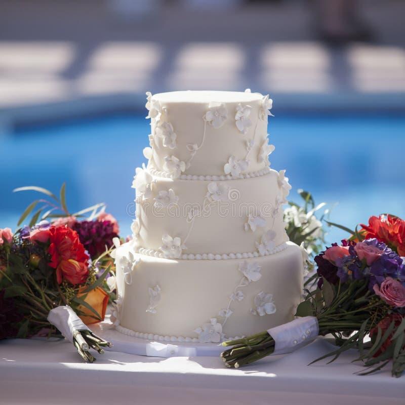 Outdoor white wedding cake stock photography