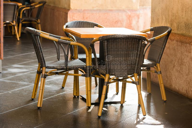 Outdoor wicker furniture in cafes royalty free stock image