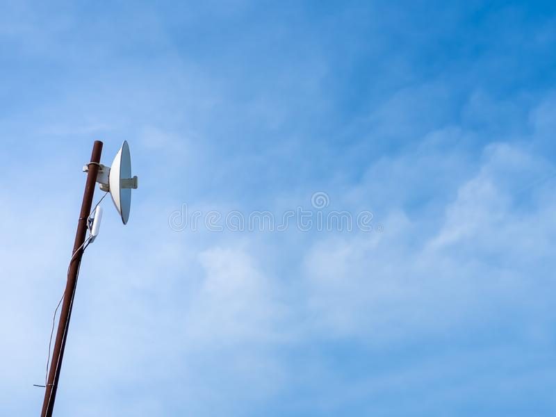 Outdoor wireless access point on the rusty pole with blue sky view background. Outdoor wireless access point on the pole with blue sky view background. A royalty free stock image