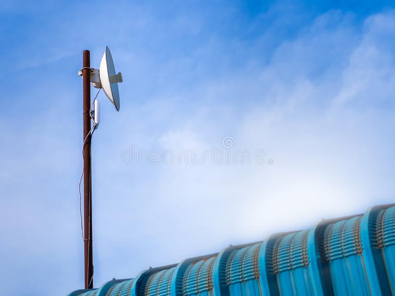 Outdoor wireless access point on the rusty pole with blue sky view background. Outdoor wireless access point on the pole with blue sky view background. A stock image