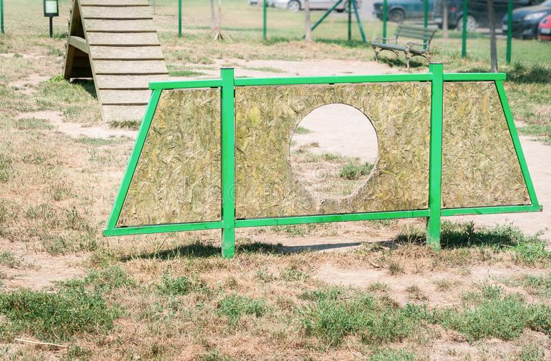 Outdoor wooden barrier to training and dressage the dog for military or police stock images