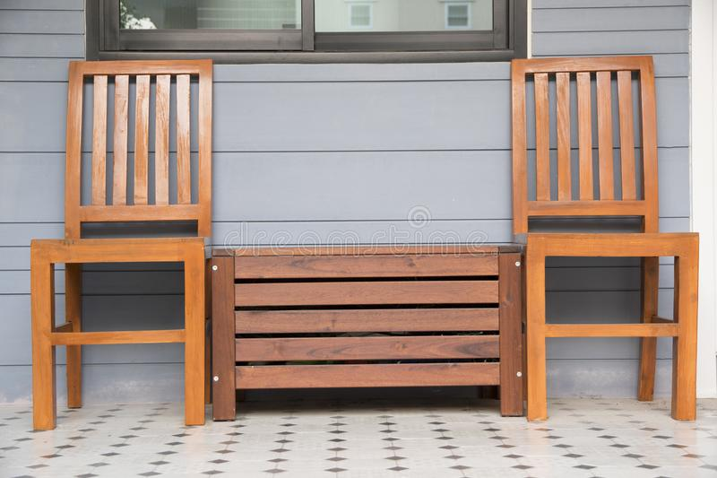Outdoor wooden chairs at terrace royalty free stock photography