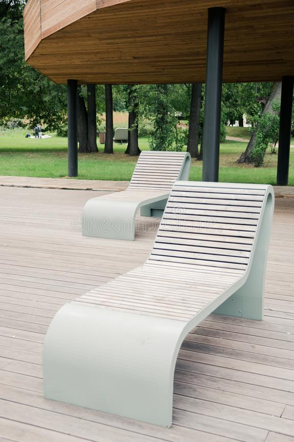 Outdoor wooden furniture made of thermally modified timber is safe for health in the city Park.  stock image