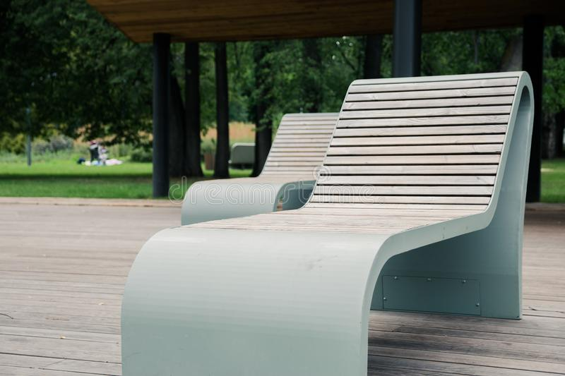 Outdoor wooden furniture made of thermally modified timber is safe for health in the city Park.  stock photos