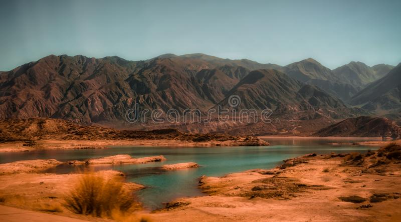 Outdoors awe inspiring nature landscape mountains background turquoise river potable water travel destinations royalty free stock photo