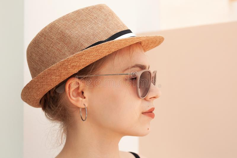 Profile portrait of a girl in hat royalty free stock photos