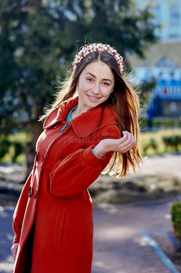 Outdoors fashion portrait of beautiful brunette woman, posing on a city street stock photo
