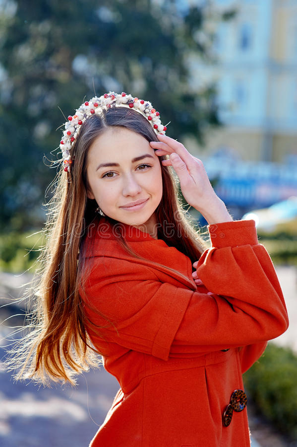 Outdoors fashion portrait of beautiful brunette woman, posing on a city street royalty free stock images