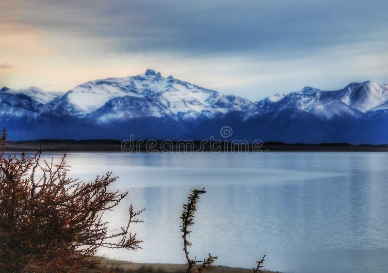 Outdoors nature awesome beauty landscape frozen winter lake snowy mountains in the background cloudy day travel destinations royalty free stock photo