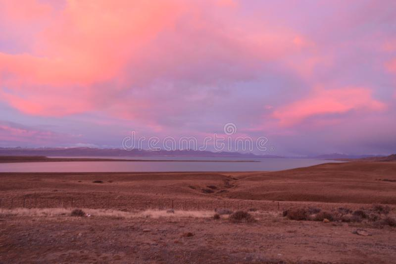 Outdoors nature awesome beauty landscape winter pink sky cloudy day calm water lake travel destinations scenic view stock photography